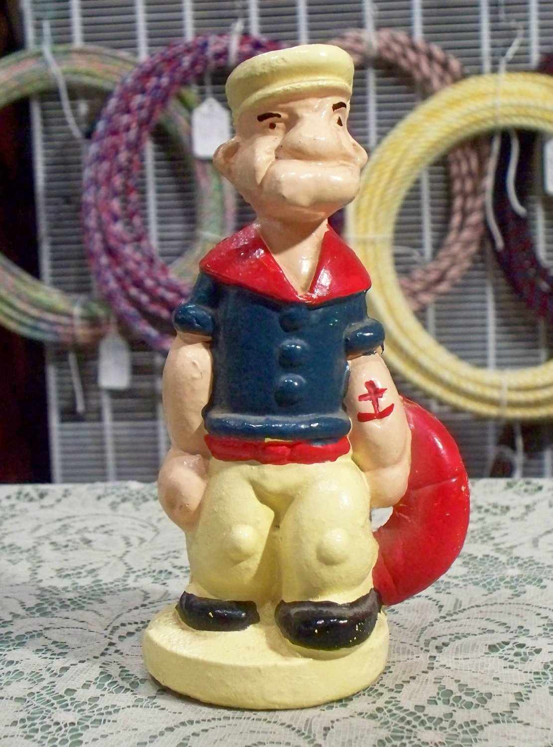 Popeye cast iron coin bank? used and empty paperweight?