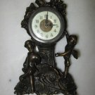 Larger bronze cherub clock
