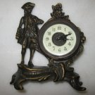 Bronze table top/mantle top clock with colonial figurin
