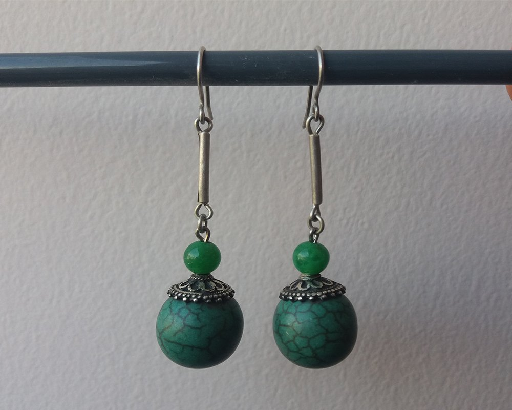 Silver earring with natural stone �calcite�, green turquoise color