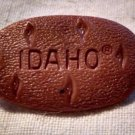 "IDAHO Potato LAPEL PIN -Plastic Potato Gem State Garnets ""Idahoans"""