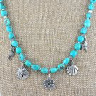Turquoise and Sterling Silver Charm Necklace