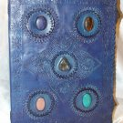 Blue journal with dual clasp and five semi precious gem stones.