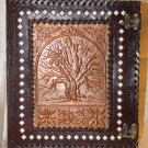 Leather journal embossed with tree of wisdom on a copper plate.