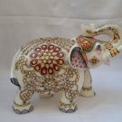 Royal Gem stone studded elephant sculpted from single block white marble.