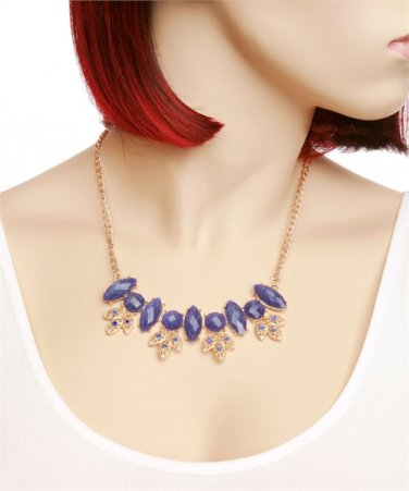 Beautiful gold tone necklace with purple stones