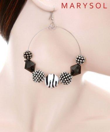 1 pair of medium hoop earrings with black, silver and zebra print beads