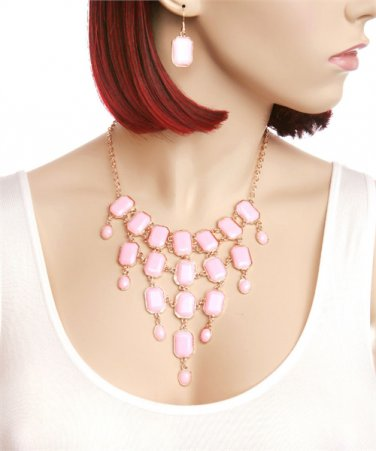 Beautiful bib necklace w/ pink stones & gold tone links matching earrings included