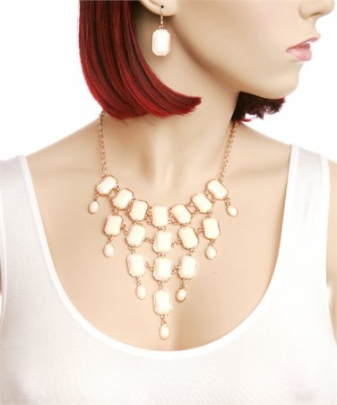 Beautiful bib necklace w/ ivory colored stones & gold tone links matching earrings included