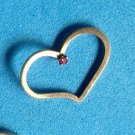 PRETTY YELLOW GOLD PLATED FLOATING HEART PENDANT WITH SMALL PRONG SET RED STONE