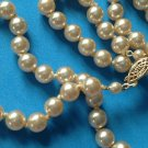 "VINTAGE CREAM COLOR KNOTTED STRAND OF COSTUME PEARLS 24"" LONG JUST UNDER 3/8"" D."