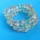 "VINTAGE ADJUSTABLE ""SPRING"" BRACELET WITH TUMBLED CLEAR & LIGHT GREEN STONES"
