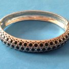 "2 SIDED TEXTURED SILVER & BLACK ENAMEL HINGED BANGLE BRACELET .5""TH. 2"" X 2.5""w"