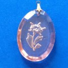 VINTAGE PINK GLASS INTAGLIO CAMEO OF A FLOWER PENDANT. GOLD TONE LOOP