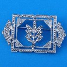 "PRETTY MARCASITE PIN IN UNMARKED SILVER TONE SETTING, 2"" X 1 1/8"""