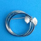 "VINTAGE STERLING SILVER TRIPLE CIRCLE WITH BOW PIN. SIGNED ""d e c """