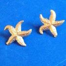 "FUN LIGHT WEIGHT GOLD TONE STAR FISH PIERCED EARRINGS @ 1 1/8"" IN DIAMETER"