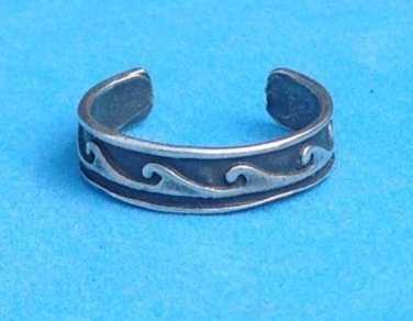 STERLING SILVER WAVE DESIGN OPEN UNI SEX BAND RING. IT'S @SIZE 4 ADJUSTABLE