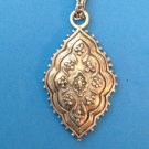 """COSTUME SILVER RAISED DESIGN PENDANT AND 24"""" CHAIN NECKLACE SIGNED """"H.L. OR T.L."""""""