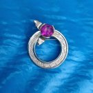 VINTAGE ENGRAVED SILVER TONE CIRCLE PIN WITH AMETHYST COLORED RHINESTONE 1 1/2""