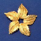 "PRETTY TEXTURED & SHINY GOLD TONE SWIRLING LEAF PIN @ 1 7/8"" IN DIAMETER"