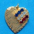 "VINTAGE RED WHITE BLUE RHINESTONE FLAG ON GOLD TONE HEART PENDANT 1"" X 1 1/8"""