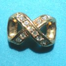 BEAUTIFUL GOLD & CLEAR STONE ETERNITY KNOT SLIDE - COSTUME