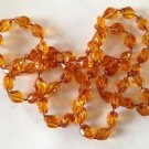 """VINTAGE LIGHT WEIGHT AMBER PLASTIC BEADED NECKLACE 35"""" LONG BY @ 3/8"""" SARAH COV."""