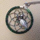 "Dream catcher pendant necklace, green & silver 1 1/4"" diameter on 18"" chain."