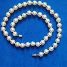 """Necklace, white faux pearl 18"""" long single strand, knotted."""
