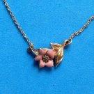 "Avon enamel flower necklace, pink on gold tone  16"" long."