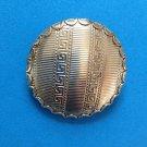 "Tara clip earrings, gold tone, greek key design. 1 1/2"" diameter."