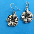 "Dangle pierced earrings, silver tone pinwheel flower  1 1/2"" x 3/4""."