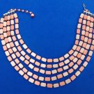 "Coral plastic necklace, Japan, 5 strand light & iridescent, up to 17"" long."