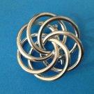 "Silvertone swirl pin, vintage 1 3/4"" in diameter."
