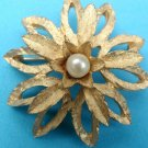 "Gold pin pearl center, flower, 1 3/4"" in diameter."