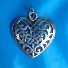 """Silver heart pendant, cut out. Unmarked. 1 3/8"""" with loop x 1  1/4""""."""