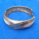 "Crown Trifari bangle bracelet. Hinged, cream enamel. Gold tone -  7/8"" x 6.5""."