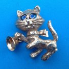 "Kitten pin, gold tone. Blue eyed cat ringing bell 1 1/2"" x 1 1/4""."