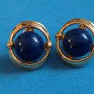 "Navy blue pierced earrings, gold tone 3/4"" x 3/8""."