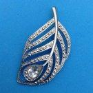 """Rhinestone silver tone pendant, flowing leaf design  2 1/2"""" x 1 1/4""""."""