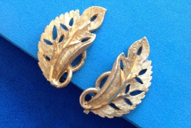 """"""" B.S.K."""" clip leaf earrings gold tone textured & shiny. Vintage."""