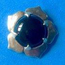 Sterling silver & onyx  pendant, stylized flower.