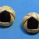 Clip on earrings, gold tone with black stone center.