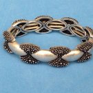"Stretch bracelet, silver tone, satin & texture finish  5/8"" thick @ 7.5""wide."