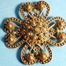 """Statement pin gold colored, 2.5"""" x 2.5""""."""