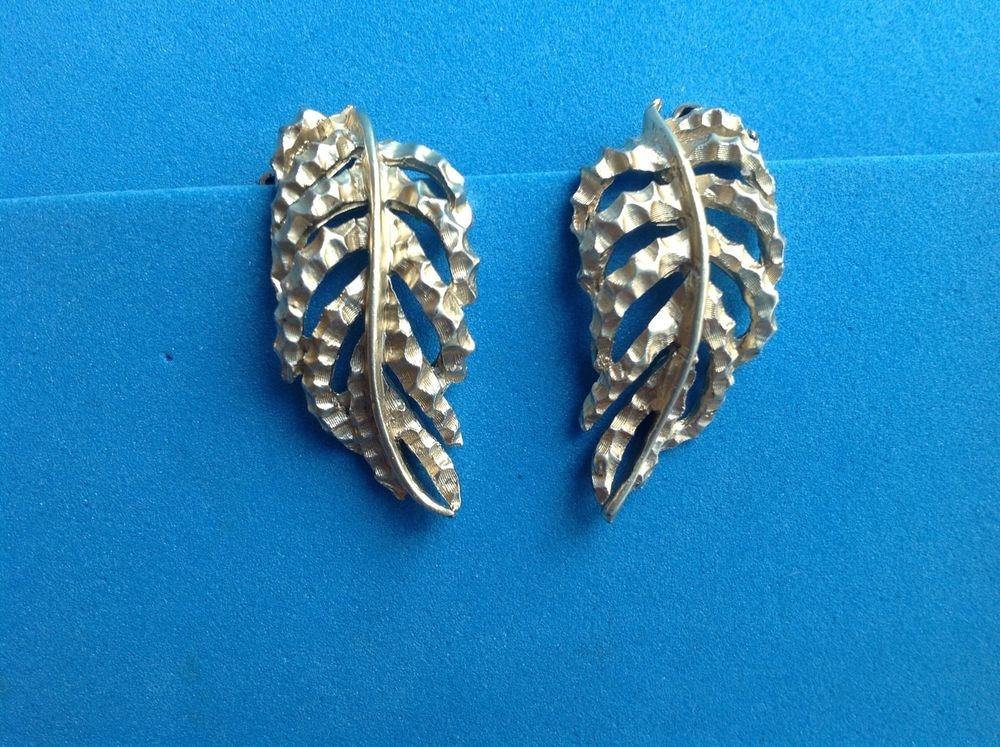 """BSK"" clip on leaf design earrings, soft gold tone."
