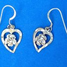 Sterling silver pierced earrings. Cut heart and rose, dangling.