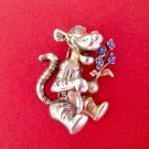 Signed Disney pin. Tigger with blue flowers gold tone  - too cute