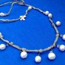 "Pearl, silk, sterling silver Bohemian dangle necklace. Artist made ""Silke 925"" ."